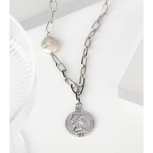 Silver chain necklace with coin pendant